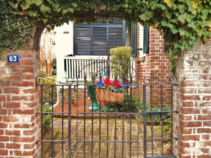 A very patriotic flower basket hanging on a beautiful Charleston gate.