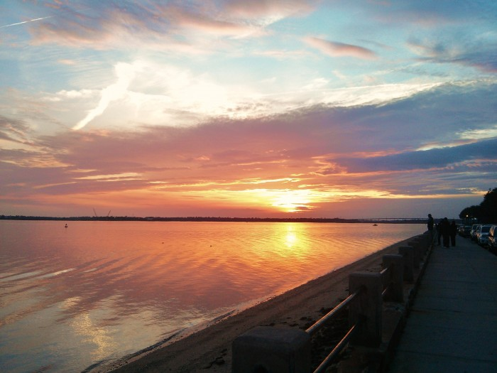 The setting sun reflected in the Ashley River, during an usually low tide, in Charleston