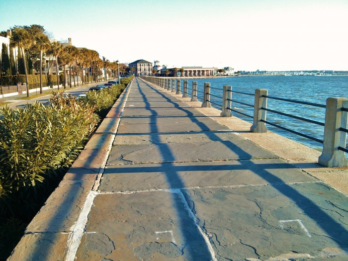 The early morning rising sun casts dramatic shadows across the High Battery in Charleston, SC.