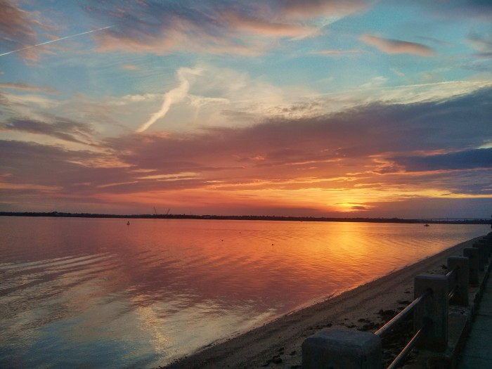The sunset as seen from the Low Battery in Charleston, SC, along the Ashley River.