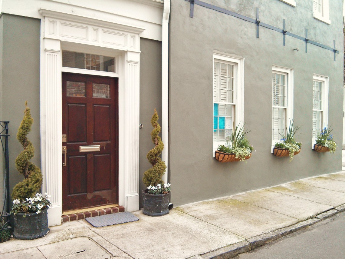 A beautiful door and flower boxes create a classic Charleston , SC scene