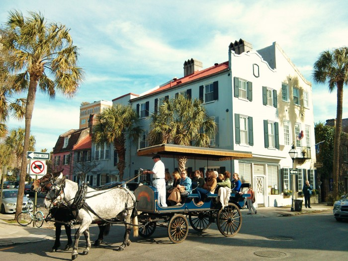A classic scene of visitors taking a carriage tour in Charleston, SC