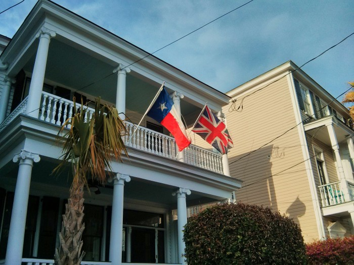 These flying flags, glowing in the late afternoon sun, can be found on Tradd Street in Charleston, SC.