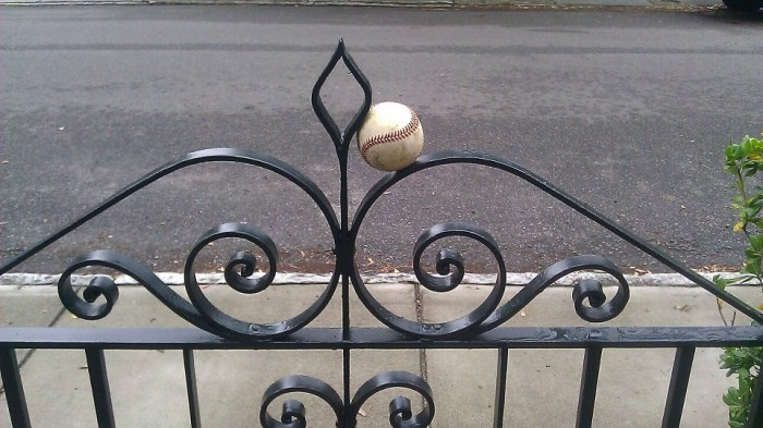 A Charleston celebration of baseball... a Philip Simmons gate catching a ball!