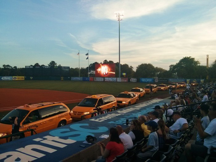 The Charleston RiverDogs, the NY Yankees Class A minor league team, arrive for player introductions for the season opener by Yellow Cab!