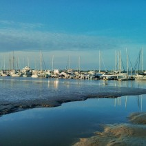 Low tide and boats at rest in the early morning Charleston light.