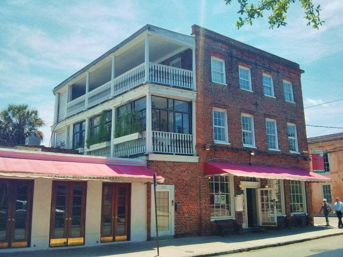 A restored Charleston single house (and more), is home to an Italian restaurant on Church Street in Charleston, SC.