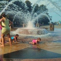 In hot summer weather in Charleston, SC cooling off in the fountains in Waterfront Park is the thing to do... especially with a friend.
