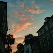 The setting sun reflecting off some clouds over the pre-colonial streets of Charleston, SC.