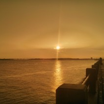 This is not a black and white photo. It is the sun setting over the Ashley River in Charleston, SC during a break in a rainstorm.