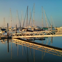 The rising sun at the City Marina along Lockwood Boulevard in Charleston, SC helps make for some beautiful reflections.