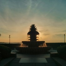 The sun rising behind the beautiful Pineapple Fountain in Charleston, SC's wonderful Waterfront Park.