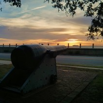 This Civil War era cannon (from the USS Keokuk) once fired shells at Fort Sumter. Now, from its home in White Point Garden in Charleston, SC., it looks like it is training its sights on a passing cargo ship or the rising sun.