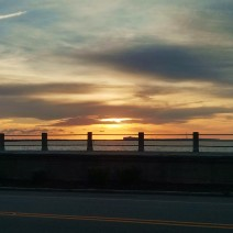 The sun rising above Charleston Harbor, Fort Sumter and the High Battery.