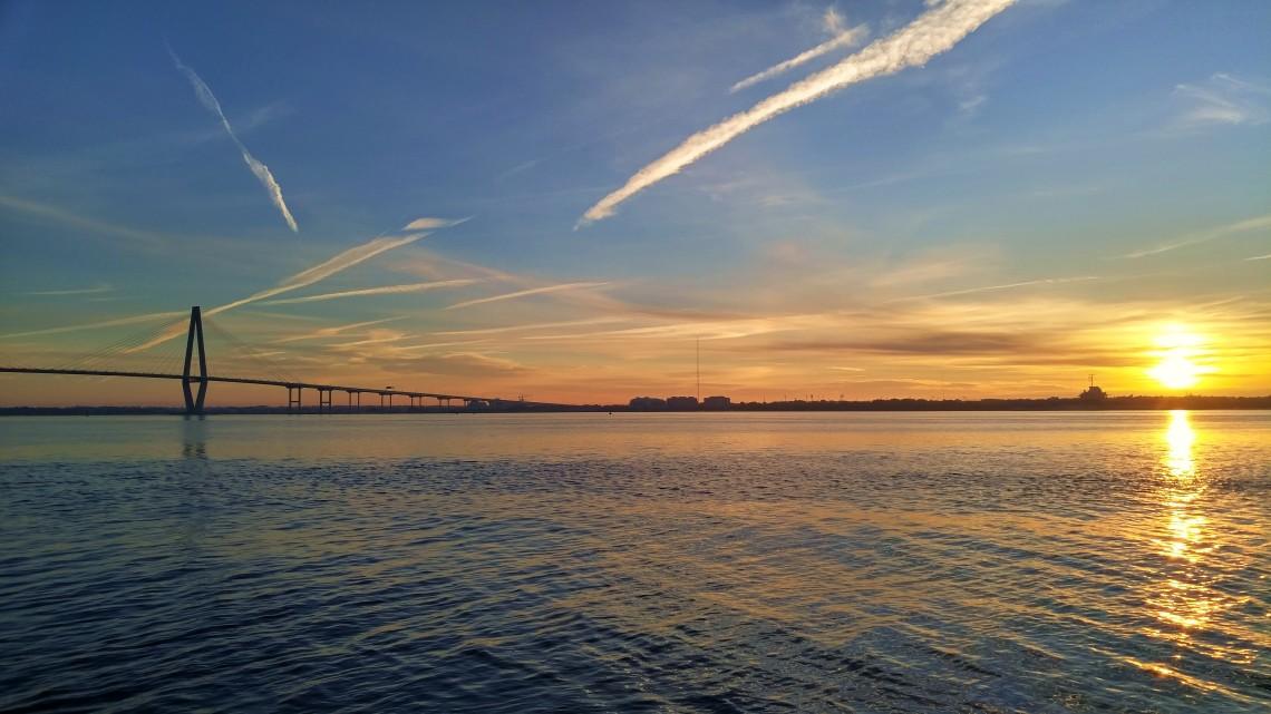 The sun rising over Charleston Harbor, illuminating the wonderful Cooper River Bridge.