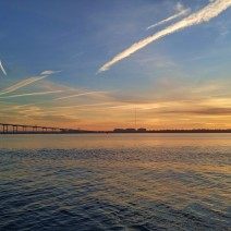 The sun rising over Charleston Harbor, illuminating the wonderful Cooper River Bridge.
