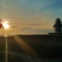 The sun rises above Charleston Harbor, illuminating Waterfront Park and its beautiful Pineapple Fountain.