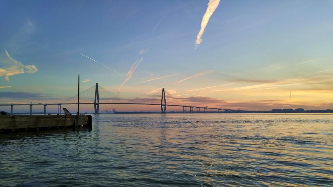The early morning sun over Charleston Harbor illuminates the Ravenel (Cooper River) Bridge.