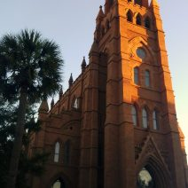 The early morning sun hitting the steeple of the Cathedral of St. John the Baptist on Broad Street in Charleston.