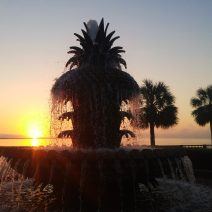 The sun coming up behind the Pineapple Fountain in Waterfront Park. in Charleston, SC.