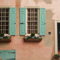 A classic Charleston scene... a beautiful old home with wonderful window boxes, ironwork, shutters and stucco.