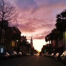 Broad Street in Charleston, glowing in the light of the setting sun.