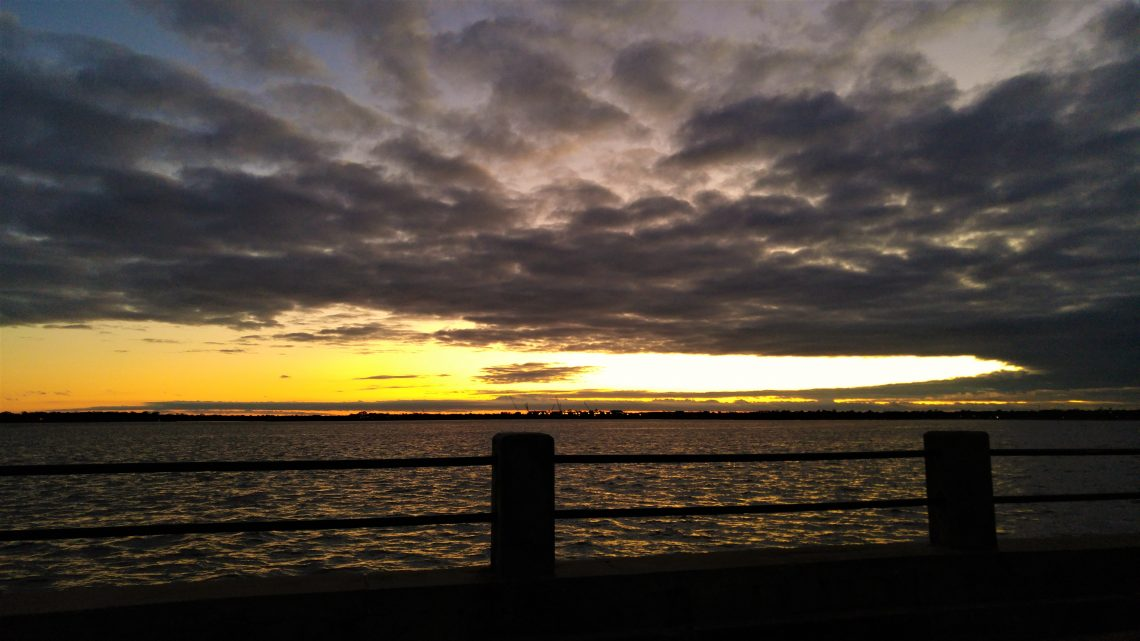 A dramatic sunset as seen from the Low Battery in Charleston.