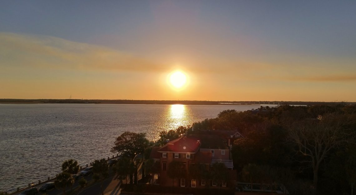The end of month sun reflecting on the Ashley River in Charleston, SC as it starts to set.