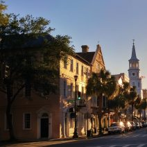 Charleston takes on a magical quality as the sun starts its downward arc. Here the south side of Broad Street, between Church and Meeting Streets, glows in the late afternoon light.