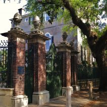 """These magnificent gates and columns, referred to as """"The Pineapple Gates,"""" are so eye-catching that the entire house -- formally known as the Simmons-Edwards House -- is referred to as the """"Pineapple Gates House."""" Located on Legare Street, the pineapples are actually carved Italian pinecones."""
