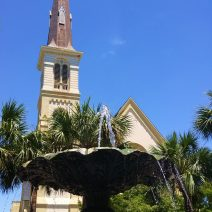 A beautiful view of the striking steeple of Citadel Square Baptist Church on Meeting Street, as seen from behind the lovely fountain in Marion Square.