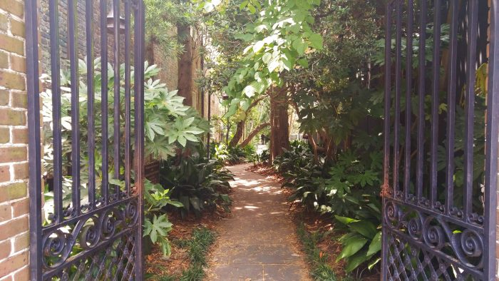 """The path from King Street to the Unitarian Church graveyard is one of the coolest """"cut-throughs"""" in Charleston. When you pass through these gates, it almost instantly takes you to another, peaceful world."""