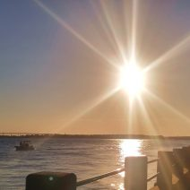 The sun going down over the Ashley River, as seen from the Low Battery.