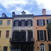 Rainbow Row is an iconic stretch of colorful connected buildings on East Bay Street in Charleston. This is not Rainbow Row. Charleston is full of amazingly beautiful, colorful buildings. You can find these on Broad Street.