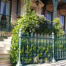 The sidewalk, ironwork and entryway of the John Rutledge House on Broad Street are iconic Charleston symbols.