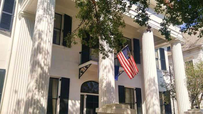 The American flag fits right in on this beautiful antebellum house on Broad Street.