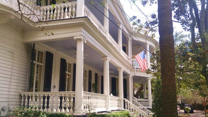 """The color of the ceiling of these Charleston porches is called """"Haint Blue."""" It is believed that it will keep the """"haints"""" (spirits of the dead) from hanging out in that house."""