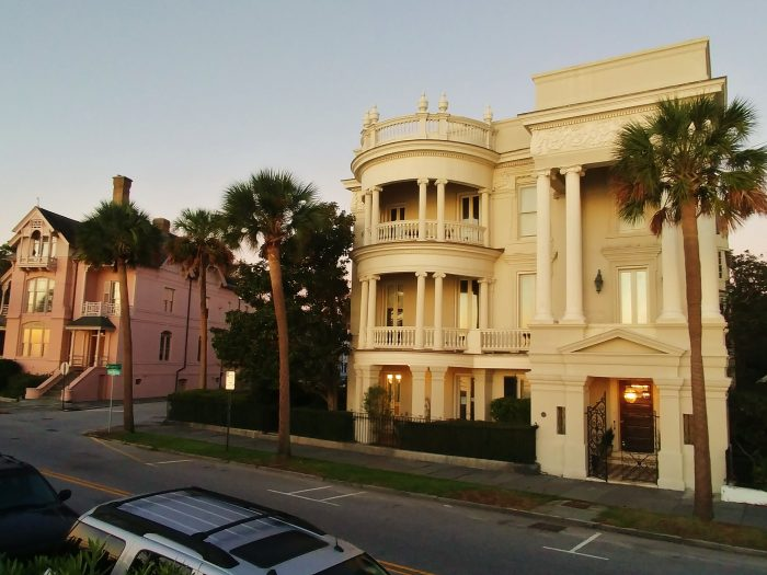 """This house on East Battery is one of the most photographed in Charleston. The popular explanation for why one side is rounded and the other is squared is that the husband and wife who built it could not agree on a design. So one designed one half, the other designed the other half. Thus, it is called the """"Compromise House."""" The true story, however, seems to be that during a renovation about 40 years after it was built, the owner decided to simply mix two styles of architecture. An interesting footnote to the history of the house is that during World War II, John F. Kennedy had an office in this house while serving as a naval officer -- before heading to the Pacific as the commander of PT109."""