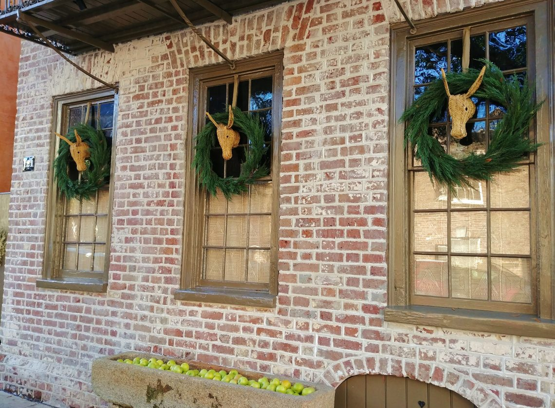 These interesting holiday decorations (and don't miss the stone trough filled with green apples) are on Church Street in Charleston.