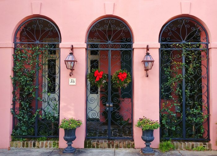 A beautiful set of gates on Rainbow Row in Charleston, decked out for the holidays.