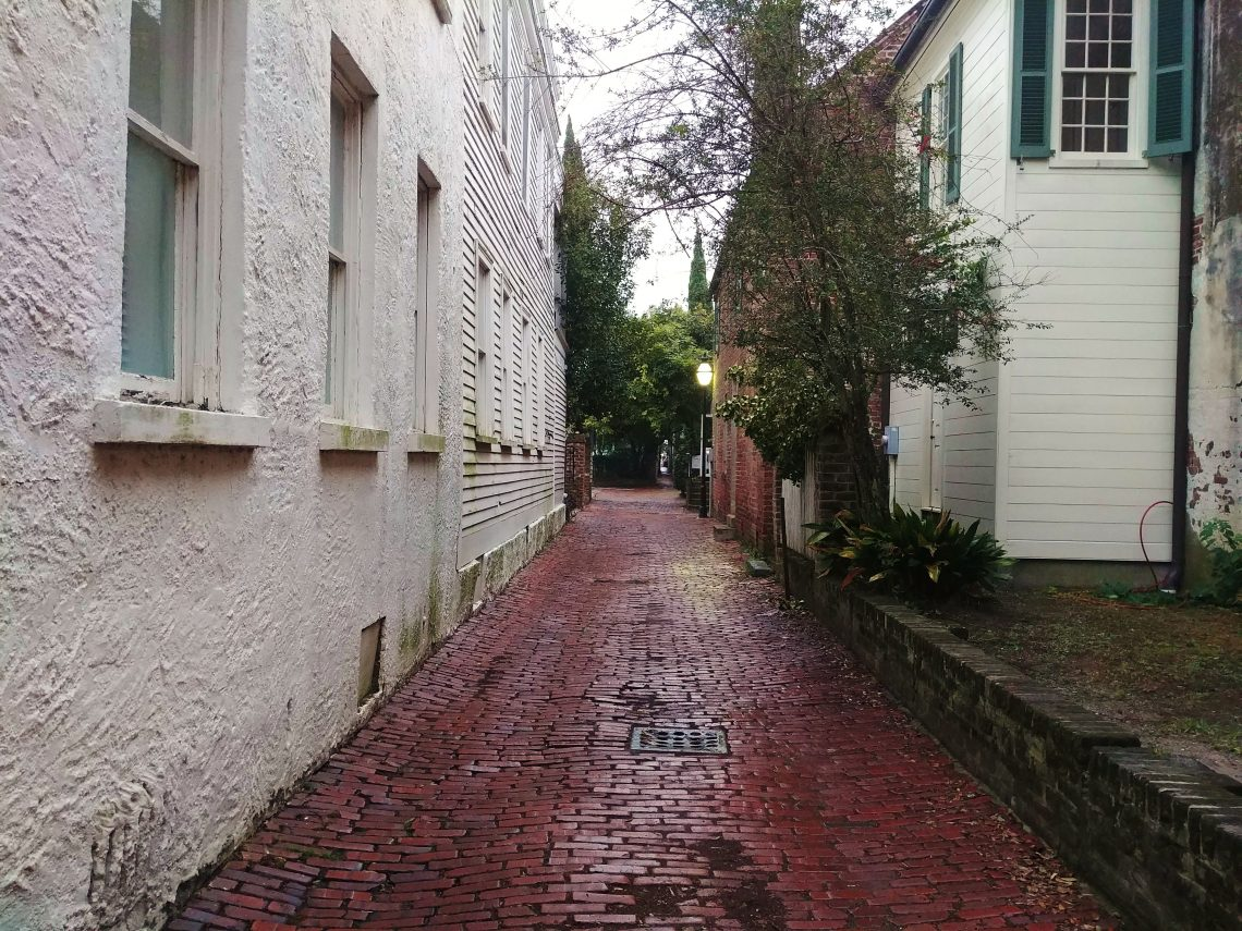 Stoll's Alley is one of the wonderful cut-throughs in downtown Charleston. Once called Pilot's Alley, it runs between Church and East Bay Streets. At its narrowest, it's about five feet wide!