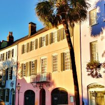 The early morning sun lights up some of the attached antebellum homes that make up Charleston's famous Rainbow Row.