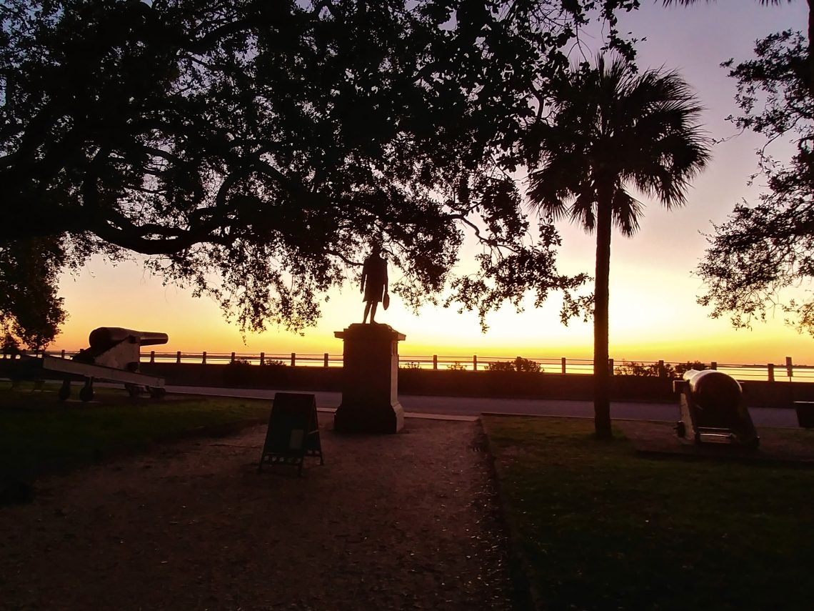 General Moultrie is greeting the dawn at White Point Garden, as he looks across the harbor to the fort that bears his name on Sullivan's Island.