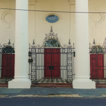 These beautiful red doors, protected by the wonderful iron fence and gates, are found at St. John's Lutheran Church on Archdale Street. Built in 1816-18, to replace a wooden structure, it is believed to have been designed by Frederick Wesner -- who also designed the Old Citadel building, as well as the portico of the South Carolina Society Hall. Interestingly, the ironwork was designed by Wesner's brother-in-law, Abraham P. Reeves.