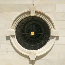 """This """"porthole"""" can be found on the front ofCharleston City Hall. With some identical twins along the sides of the building, this iconic beautiful iron and stone work is a quick identifier for this significant Charleston building. Have you posed in front of one?"""
