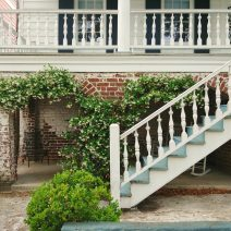 This house on John Street, which was built about 1885, has some beautiful details -- including some wonderful blooming Confederate Jasmine. Both stories of the house are fronted by a porch (which is not a piazza -- as those appear on the side of Charleston single houses), providing a beautiful setting for catching the evening breeze.