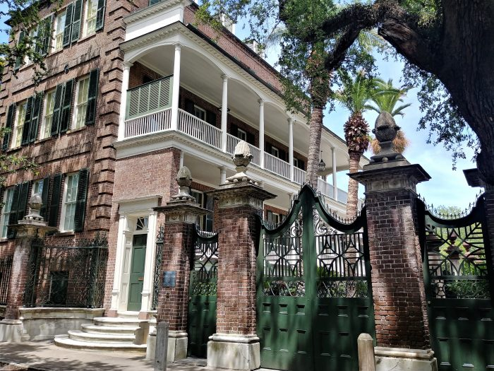 "The Simmons-Edwards House on Legare Street is one of the most spectacular houses and properties in Charleston. It is ore popularly known as the Pineapple Gates House, for obvious but inaccurate reasons. The ""pineapples"" are actual stylized Italian pine cones. But, pineapples would be good too, as they symbolize ""welcome"" or ""hospitality."""