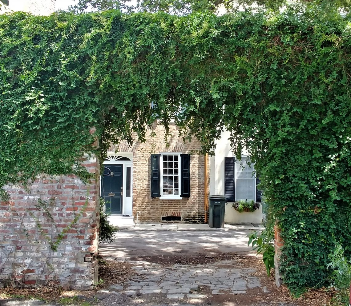 This ivy covered archway frames some beautiful antebellum houses (circa 1800) on Elliot Street in downtown Charleston. There is a series of brick archways that line part of the street.... beautiful.