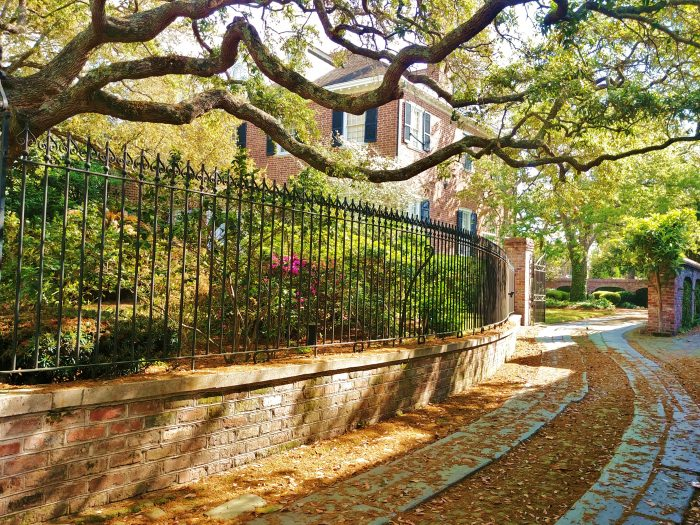This beautiful driveway, bordered by a great iron fence and a majestic live oak, leads to a handsome brick house on Legare Street. This block, between Tradd Street and Lamboll Street, holds some of the most wonderful Charleston houses -- including the Sword Gate house, which is on the market for about $20 million.