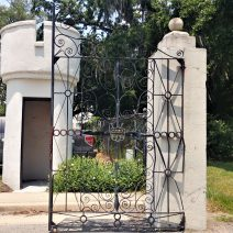 This gate, inspired by the famous Sword Gate by Christopher Werner, was actually made for General Charles Pelot Summerall's plantation in Aiken, SC.  You can see his 4 stars and initials in the shield in the center of the gate. It now hangs at the Citadel, the Military College of South Carolina and is, aptly, called the Summerall Gate. It now guards the entrance from the Citadel to Hampton Park.